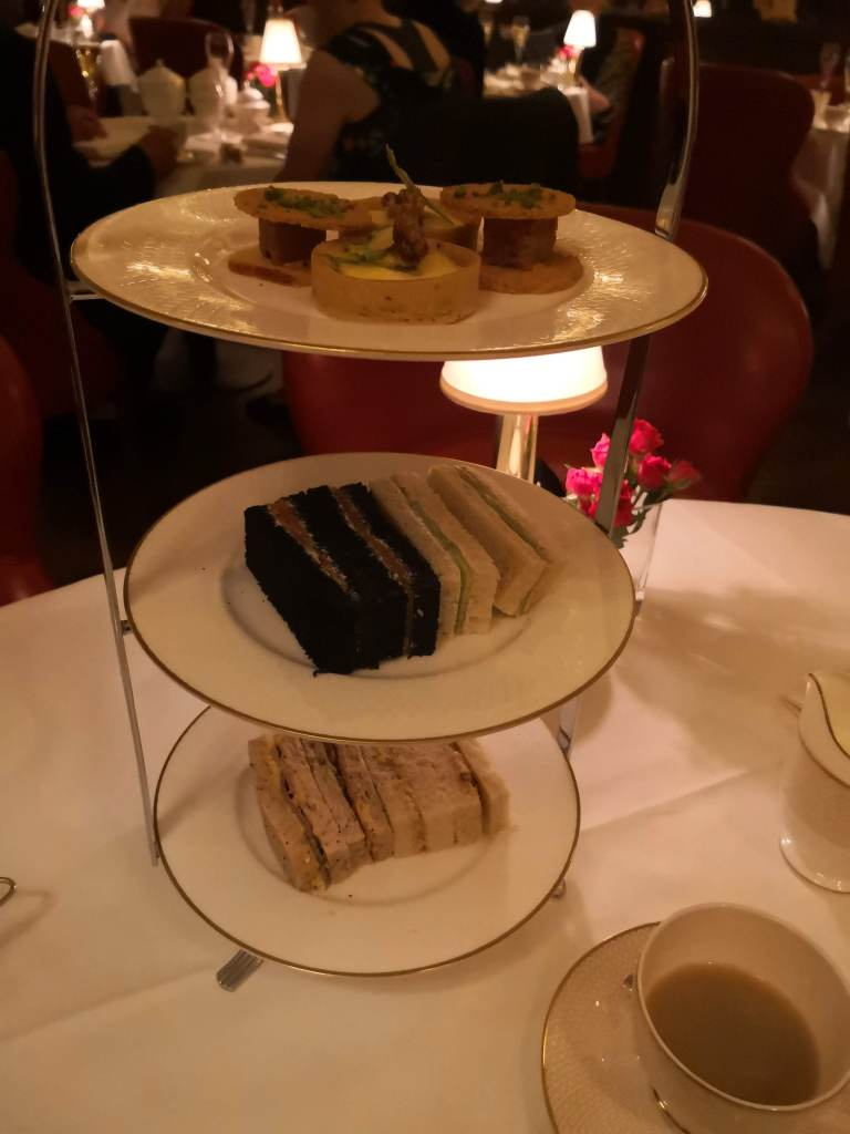 Queen of Afternoon Tea china stand and sandwiches