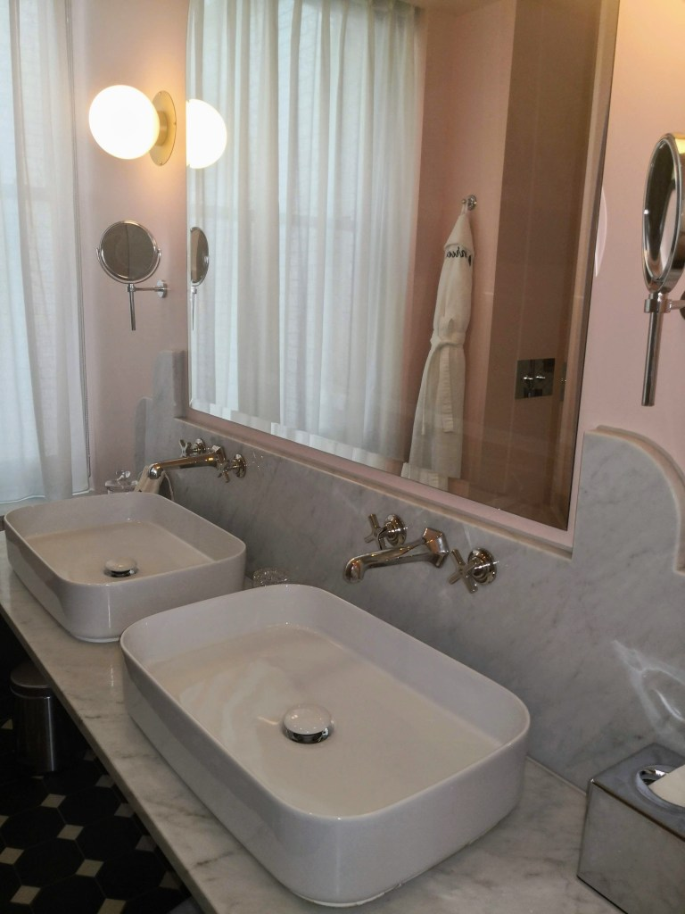 Henrietta hotel sinks in bathroom