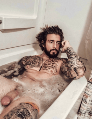 bearded bloke inked in bath god
