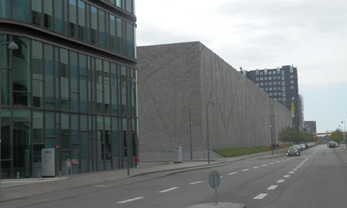 the building further away (brown, square one) is the Danish National Archives