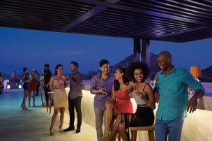 Breathless Cabo San Lucas Resort & Spa - Open-air Purple VIP Rooftop Lounge at dusk