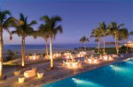 Dreams Los Cabos Suites Golf Resort & Spa - Weddings - A nighttime aerial shot of the Gala Event featuring the sandy-white beach, Sea of Cortez and shimmering pool