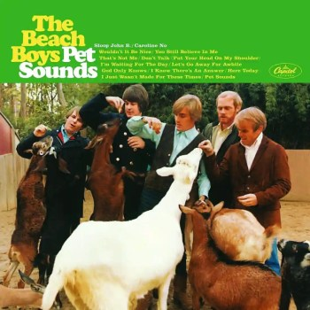 The album cover for The Beach Boys' Pet Sounds. The band members feed various farm animals and a green banner at the top bears the band name in yellow, the album name in white and lists the tracks in small yellow lettering.