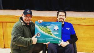 "Graham Ferguson and David Theriault with the 2019 Long Point Biosphere's ""Sustainable Tourism Award"""