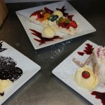 homemade strawberry pavlova, chocolate fudge cake and raspberry and white chocolate roulade.