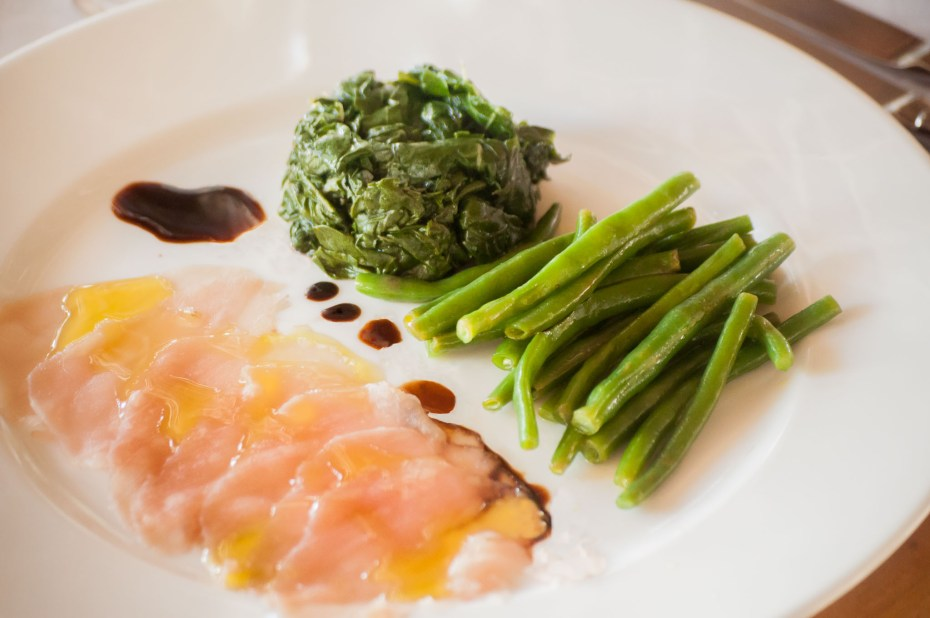 Tuna Carpaccio Raw tuna slices, served with spinach and French beans, all seasoned with olive oil and lime, with balsamic vinegar drops