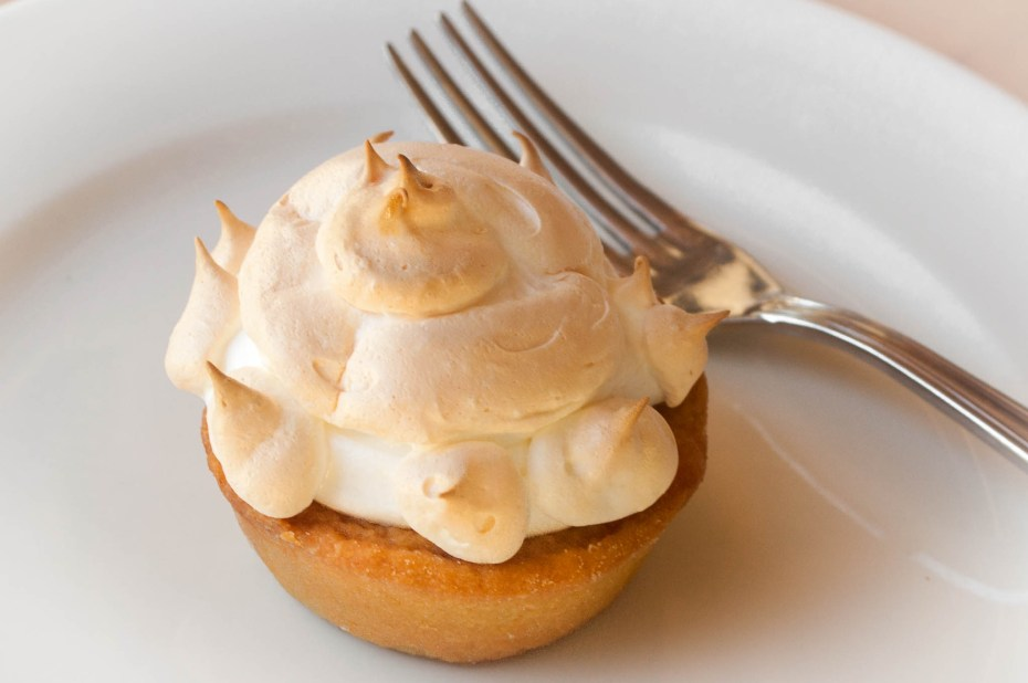 Passion meringue pie. Shortcrust pastry shell, filled with a custard and passion fruit cream, topped with a soft meringue