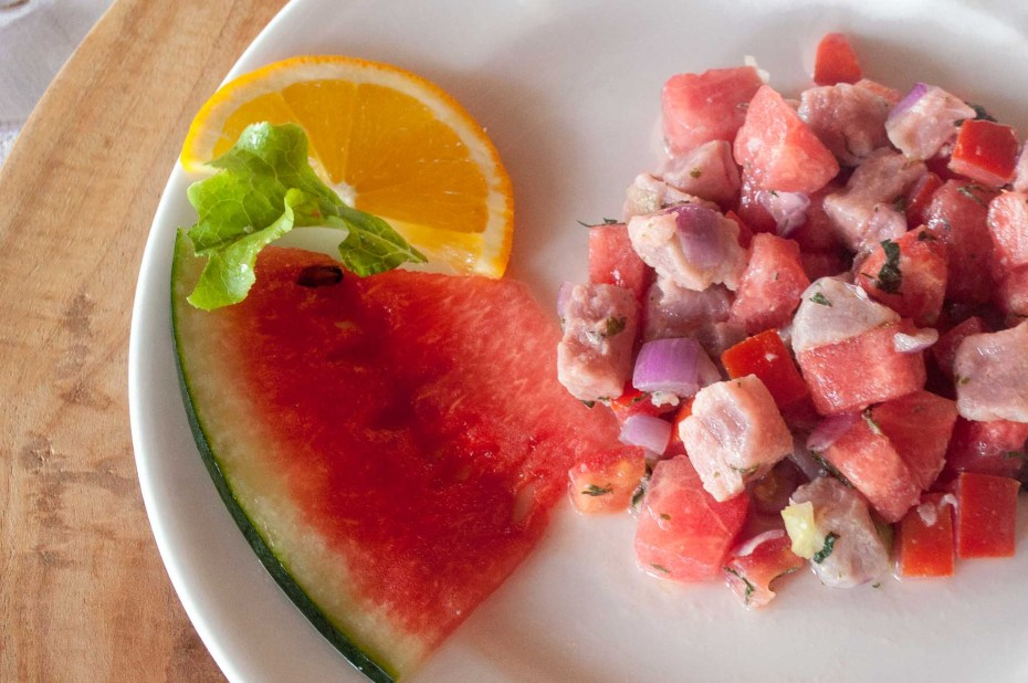 Watermelon tuna ceviche. Tuna cubes marinated with lemon and orange juice, mixed with watermelon cubes, chopped onions and mint