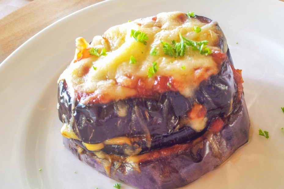 Melanzane alla parmigiana. Aubergine slices layers with tomato sauce and mozzarella cheese, baked in the oven