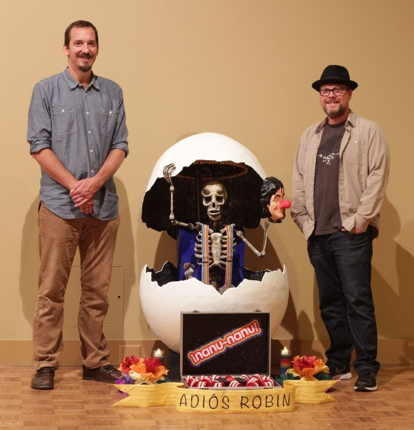 Steve Miller and Alex Goecke finished installing their ofrenda at the DIA.