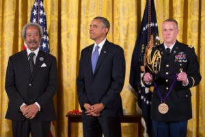 Allen Toussaint (left) receiving the Medal of Honor for the Arts from President Obama July 10, 2013, at the White House.