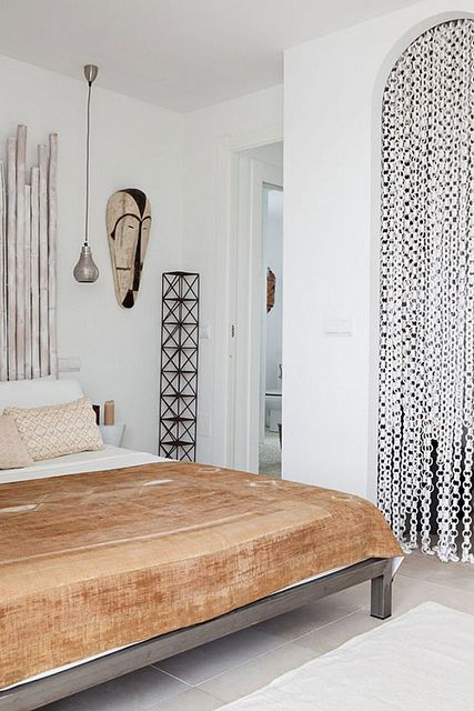 Minimalistic bedroom with hints of Africa