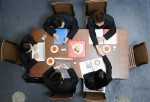 high-angle-view-five-business-executives-meeting