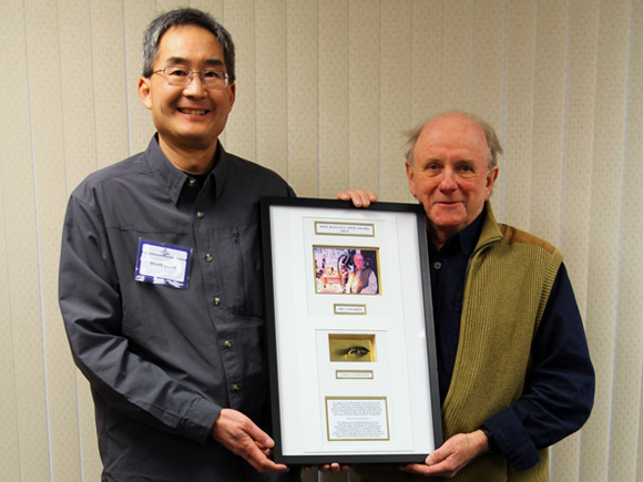 Brian Chan presenting Art Lingren with Jean-Guy Cote Award