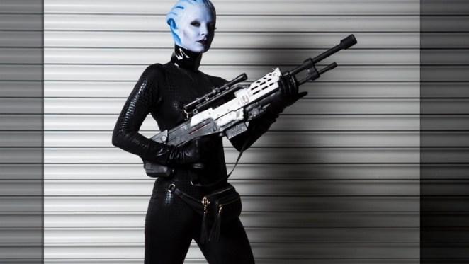 Liara holds gun in alley