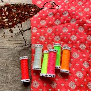 Au Ver A Soie metallic thread set in Neon at Loop London