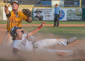 Moorfield's Hayden Baldwin shows the unpire the ball after tagging out Mna's Jace Adkins as the first out of the final inning during Class A state tournament action in Charleston. (F. Brian Ferguson/Lootpress)