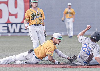 Miners secomd baseman Kenneth Melendez, left, attempts to tag out Champion City's Brady Emerson at second on a sucessful steal attempt during Wednesday evening action in Beckley. (F. Brian Ferguson/Lootpress)