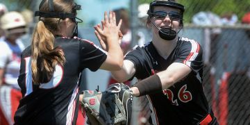 Tayven Stephenson (right) is congratulated by a  teammate. (Photo courtesy of the Charleston Gazette-Mail)