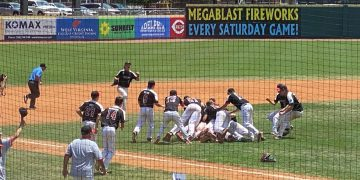 Bridgeport players celebrate after beating hurricane in Saturday's Class AAA championship game.