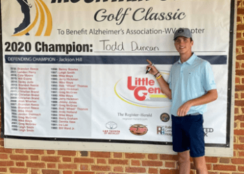 Todd Duncan, the defending Mountain State Golf Classic champion, writes his name after winning the event in 2020. (Submitted Photo)