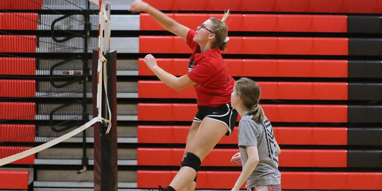 (Brad Davis/For LootPress) Greater Beckley Christian player Emma-Grace Holstein spikes a ball as she and teammates work through drills during practice August 30 in Prosperity.