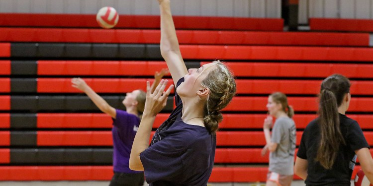 (Brad Davis/For LootPress) Greater Beckley Christian player Jessica Arrington works on serves as she and teammates practice August 30 in Prosperity.