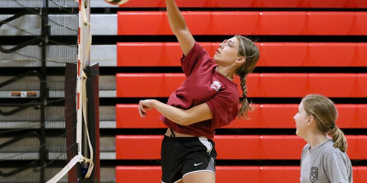 (Brad Davis/For LootPress) Greater Beckley Christian player Jada Wilcox spikes a ball set by teammate Jenna Fisher during practice August 30 in Prosperity.