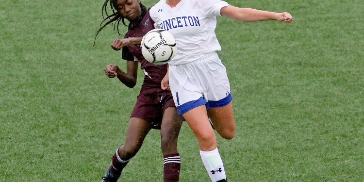 (Brad Davis/For LootPress) Princeton's Reagan Southers battles for possession with Woodrow Wilson's Ama Ackon-Annan Tuesday evening at the YMCA Paul Cline Memorial Sports Complex.