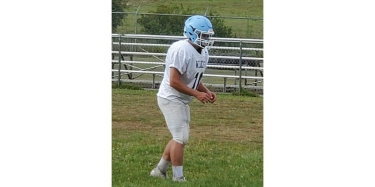 Meadow Bridge quarterback Dustin Adkins prepares to take a snap during practice on Tuesday. (Rusty Udy)
