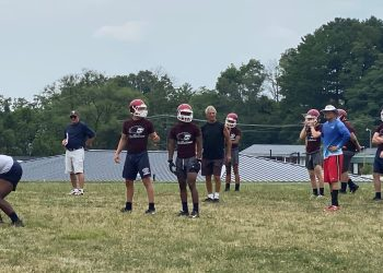 Bluefield offensive coordinator Fritz Simon (red shirt) directs the offense during a practice on Wednesday at Bluefield High School.