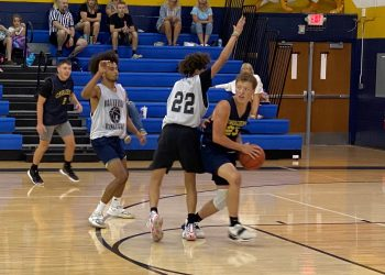 Greenbrier West's Chase McClung (right) looks to pass out of a trap during a game against Bluefield on July 19 in Shady Spring.