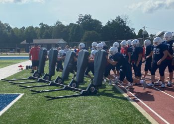 The Independence linemen take turns pushing the sled during a hot practice on Aug. 11.