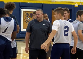 Shady Spring coach Ronnie Olson instructs his team during a timeout on July 19 at Shady Spring.