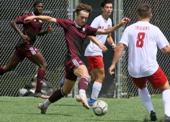 (Brad Davis/For LootPress) Woodrow Wilson's Carson Eckley receives a pass as he's converged on by Bridgeport defender Brody Nolte (#8) Saturday afternoon at the YMCA Paul Cline Memorial Sports Complex.