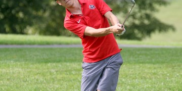 (Brad Davis/For LootPress) Oak Hill's Jack Hayes chips onto a green during a high school golf event at Bridge Haven Golf Club on Sept. 25 afternoon.