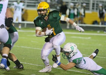 (Brad Davis/For LootPress) Greenbrier East's Ian Cline breaks a tackle attempt from Robert C. Byrd's Evan Warne as he carries the ball Friday night in Fairlea
