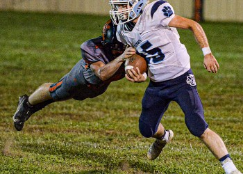 File Photo - Meadow Bridge's James McClure picks up yards against Summers County during action in Hinton on Oct. 16. (F. Brian Ferguson/Lootpress).
