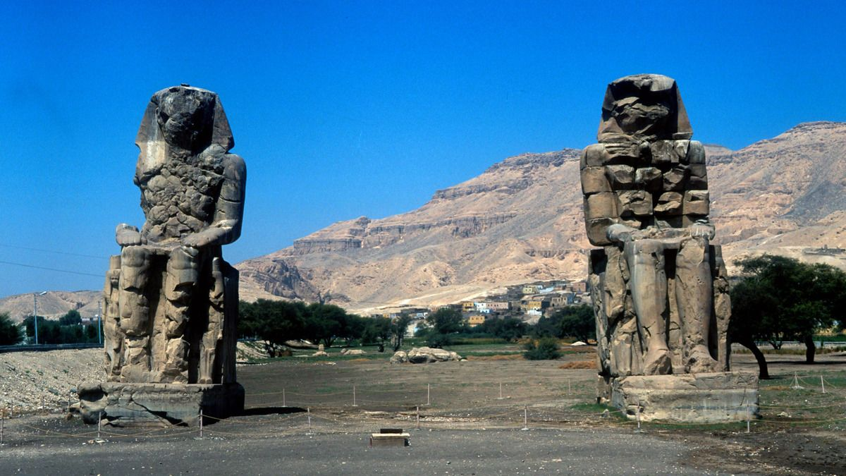 The Colossi of Memnon, near the Valley of the Kings, Egypt, 14th century BC.