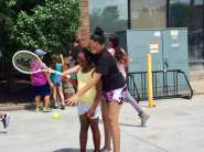Learning tennis skills at LCCC/USTA Tennis Play Days