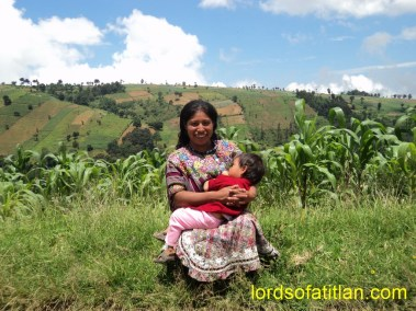 This woman fromMocolic Xot Alto,  Patzún breast-feeds her daughter with Chuiquel in background. She is from Mocolic Xot, however. Patzún has several poor rural communities, but none poorer than Mocolic Xot.