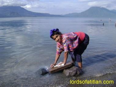 Woman from Santa Catarina Palopó washing in Lake Atitlán but in in Panajachel