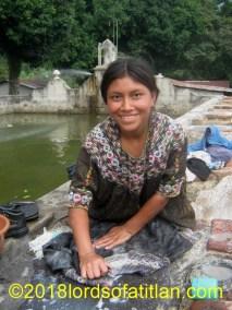 Woman from Joyabaj washing in public pila but in the finca Pampojilá, San Lucas Tolimán