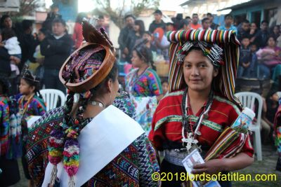 The young woman on the left represented El Tejar, Chimaltenango. Her patron saint is therefore San Sebastián celebrated January 19th. Also, her idiom is kaqchiquel. Her dancing partner is from Comitancillo, San Marcos, however. She therfore celebrates Santa Cruz, the 3rd of May and speaks Mam.