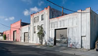 New Daylight Studios (#3246 is the grey half of the warehouse, door is next to the poinsettia shrub), photo by: Al Wengerd