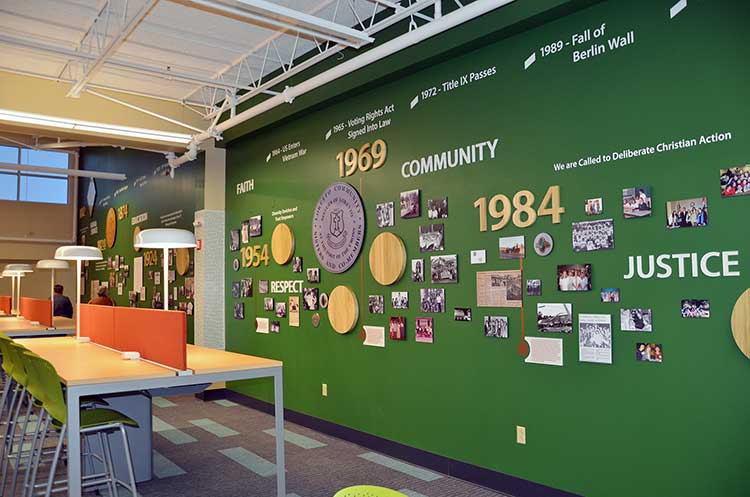 Library visitors will see a long wall display that tells the story of Loretto and Nerinx Hall. (Photo by Jean M. Schildz)