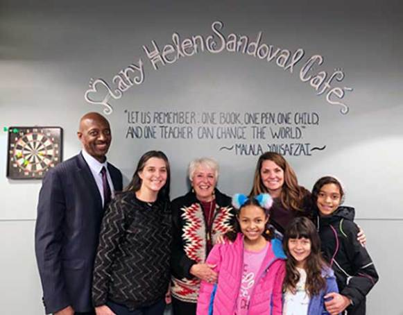 Members of Mary Helen Sandoval's family gather at her recognition ceremony at the Colorado High School Charter. Back row, from left, are Kelvin Reed, Andrea Sandoval Reed, Mary Helen Sandoval, Amanda Sandoval and Ariel Sandoval Reed. Front row, from left, are Malia Sandoval Reed and Aziza Halpern Sandoval.(Photo by Jackie Coppola)
