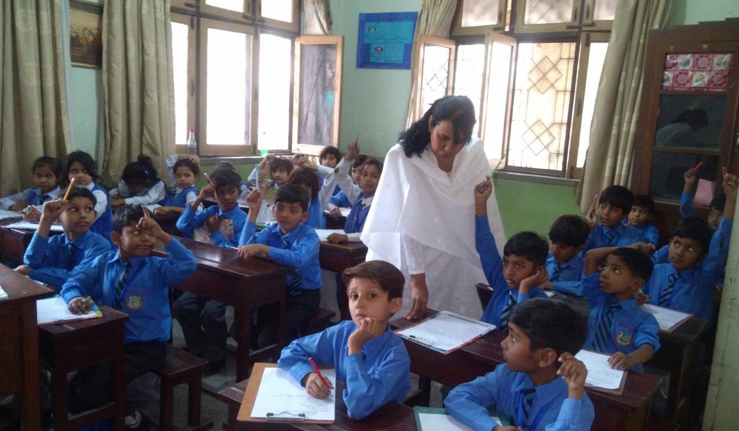Maria Daniel SL is shown working with students in a classroom.