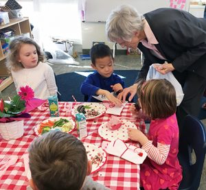 Bernie Feeney SL talks with elementary children
