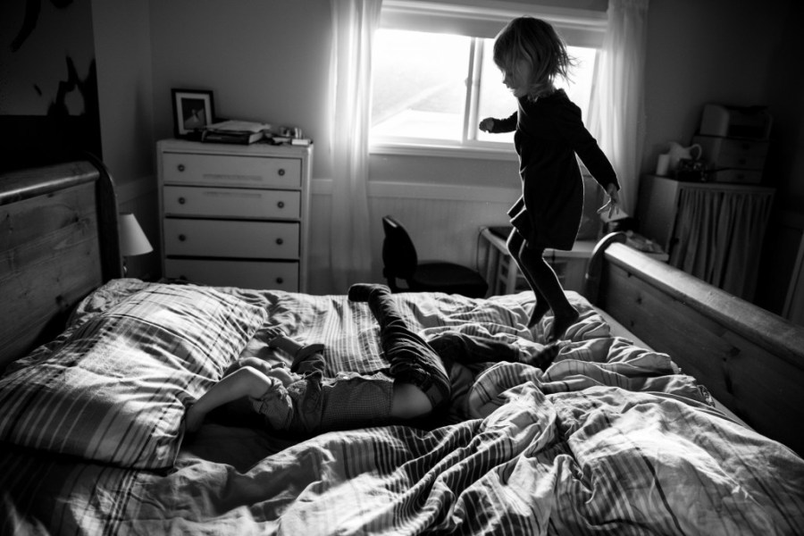 What is Documentary Photography  kelowna and okanagan family documentary session  jumping on bed